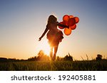girl with balloons jumping... | Shutterstock . vector #192405881