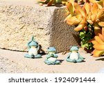 A Group Of Three Green Ceramic...