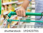 woman with shopping cart in... | Shutterstock . vector #192423701