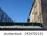 Barbed Wire On A Background Of...