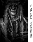 Small photo of American Indian chief with big feather headdress, warrior