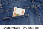 Small photo of Russian money in my pocket. Bills in the back pocket of jeans. The concept of pocket money. Cash. Business, trade or financial transactions.