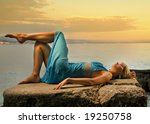 young woman relaxing near the... | Shutterstock . vector #19250758