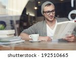 smiling hipster man reading... | Shutterstock . vector #192510665