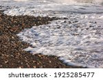 A Stormy Sea Wave Runs Onto A...