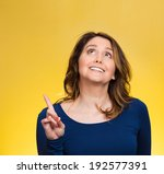 Small photo of Closeup portrait surprised young happy, funny woman, just came up with idea aha, index finger pointing, looking up isolated yellow background. Positive human emotion, facial expression, feeling, sign