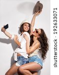 two young women taking picture... | Shutterstock . vector #192633071