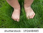 Small Baby Feet On The Green...