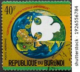 "Small photo of Republic of Burundi - CIRCA 1974: Postage stamp ""Carrier Pigeon and Globe"" printed in Republic of Burundi. Series: ""Centenary of Universal Postal Union"", airmail, 1974"