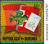 """Small photo of Republic of Burundi - CIRCA 1974: Postage stamp """"Swiss flag and Pigeon with letter"""" printed in Republic of Burundi. Series: """"Centenary of Universal Postal Union"""", airmail, 1974"""