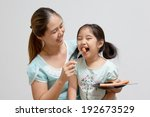 asian mother feeding sausage to ... | Shutterstock . vector #192673529