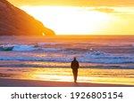 Man On Ocean Beach At Sunset....