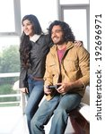 young indian couple relaxing... | Shutterstock . vector #192696971