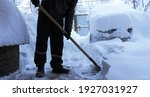 A Man With A Shovel Clears A...