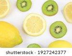 Lemons And Kiwis On White Table ...