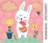 cute bunny hugging an easter egg | Shutterstock .eps vector #1927310957