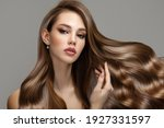 Small photo of Portrait of a beautiful brunette woman with long wavy hair. Copycpase