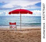Lifeguard Chair And Parasol At...