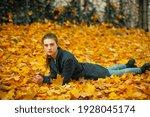 Girl Lying On Fallen Leaves In...