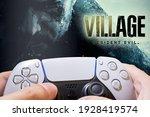 Small photo of Man play Resident Evil Village demo on Playstation 5, 3 Mar 2021, Sao Paulo, Brazil.