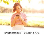 young woman using a smartphone... | Shutterstock . vector #192845771