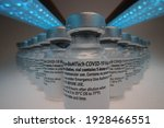 """Small photo of """"Darmstadt, Germany - 02.03.2021:Pfizer-BioNTech COVID-19 Vaccine """"comirnaty"""" original vaccine vial with condensation droplets arranged in a group"""
