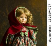 A Vintage Doll With A Beautiful ...