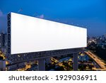 Small photo of Blank white road billboard with KL cityscape background at night time. Street advertising poster, mock up, 3D rendering. Side view. The concept of marketing communication to promote or sell idea.