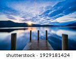 Vibrant Sunset Wooden Jetty At...