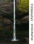 A Vertical Shot Of A Waterfall...