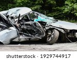 Small photo of Auto accident. Crashed car in the street. Damaged car after collision