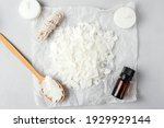 Small photo of Basic set for home-made natural white eco-friendly soy wax candles, wick, perfume. Idea for a hobby, business. Making trendy diy candles without harm to health on white background, top view
