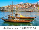 Cityscape of the city of Porto, Douro river with its old boat and its typical colored houses on the water