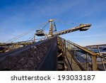 loading iron ore conveyor machine from the warehouse, mining production