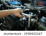 Mechanic Using A Wrench And...