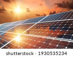 Small photo of Photo collage of sunset and solar panel, photovoltaic, alternative electricity source - concept of sustainable resources