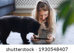 Tween girl with smartphone and...