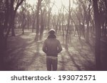 lonely man in a forest  | Shutterstock . vector #193072571