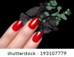 Fingers with elegant red nails and crumbled eyeshadow. Manicure and makeup concept. Closeup image isolated on black background - stock photo