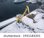 Cargo Crane In A Snowy Port....