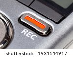 Small photo of Red REC recording button on a modern pocket audio voice recorder, switch object macro extreme closeup Secretly recording, journalist or reporter equipment, simple live music recording abstract concept