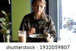 young woman eating vegan... | Shutterstock . vector #1932059807