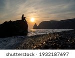 A Girl On The Beach Watches The ...