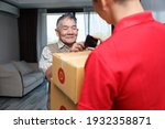 Asian Old Man Accept Supplies...