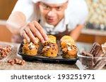asian man baking homemade cup... | Shutterstock . vector #193251971