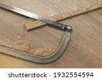 a hacksaw saw lies on the floor ... | Shutterstock . vector #1932554594
