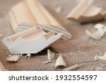 a piece of wood with sawdust... | Shutterstock . vector #1932554597