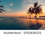 Luxury pool sunset  palm tree...