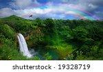 Waterfall In Kauai With Rainbo...