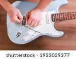 Guitar Master Restringing...